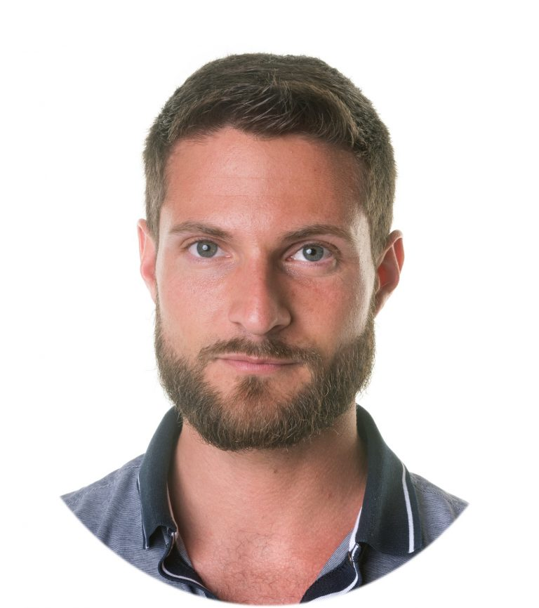 young bearded man in front of white background